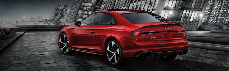 Three-quarter rear-view of the Audi RS 5 Coupe parked.