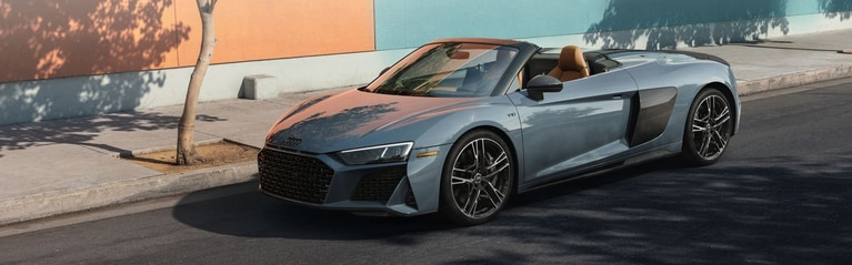 Three-quarter front profile of the Audi R8 Spyder.