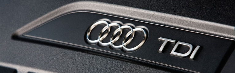 View of Audi rings and TDI badging, exclusive to diesel vehicles.