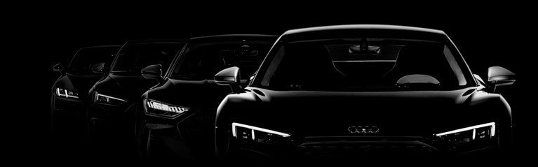 Front silhouettes of Audi Sport lineup with their LED headlights.